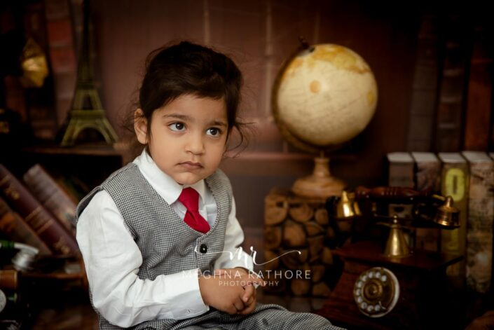 2 year old kid in professional suit posing for meghna rathore photography in delhi gurgaon