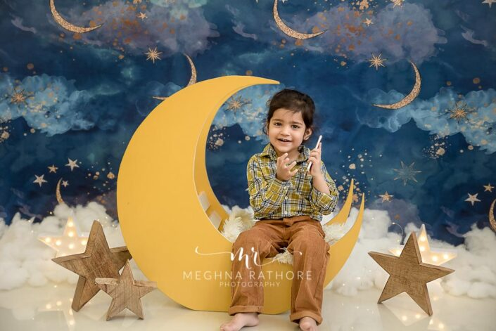 2 year old kid sky themed with big moon props professional photoshoot at meghna rathore photography in delhi gurgaon