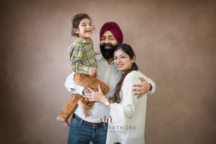 Family portrait of 2 year old boy and his parents posing at meghna rathore photography in delhi gurgaon