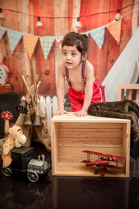 2 year cute old boy posing with different props for professional photoshoot at meghna rathore photography in delhi gurgaon