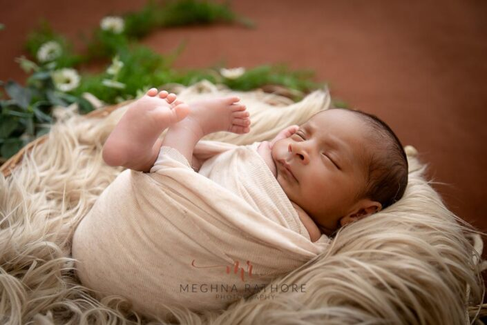 21 days old newborn baby boy professional photoshoot white and green colored props meghna rathore photography in delhi and gurgaon