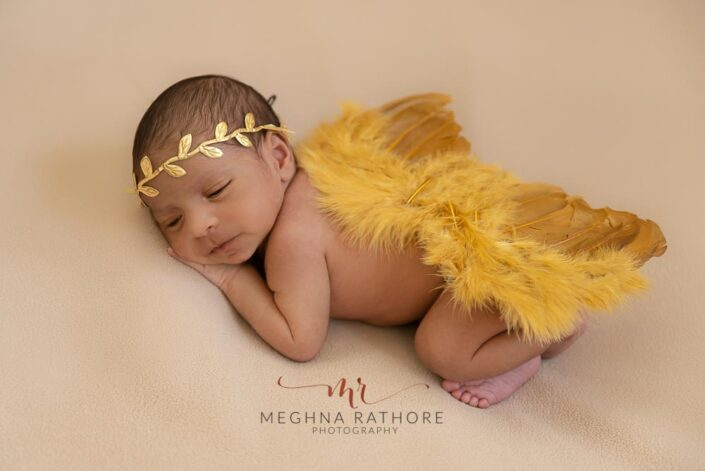 21 days old newborn baby boy photoshoot yellow colored props meghna rathore photography