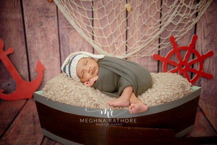 21 days old newborn baby boy in ship themed photo session at meghna rathore photograph in delhi