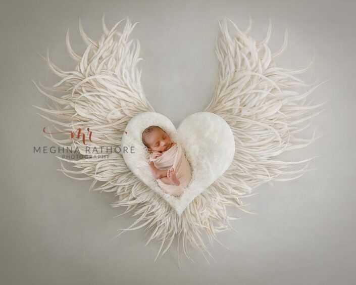 21 days old newborn baby boy photoshoot props like heart shaped basket and wings at meghna rathore photography in delhi and gurgaon