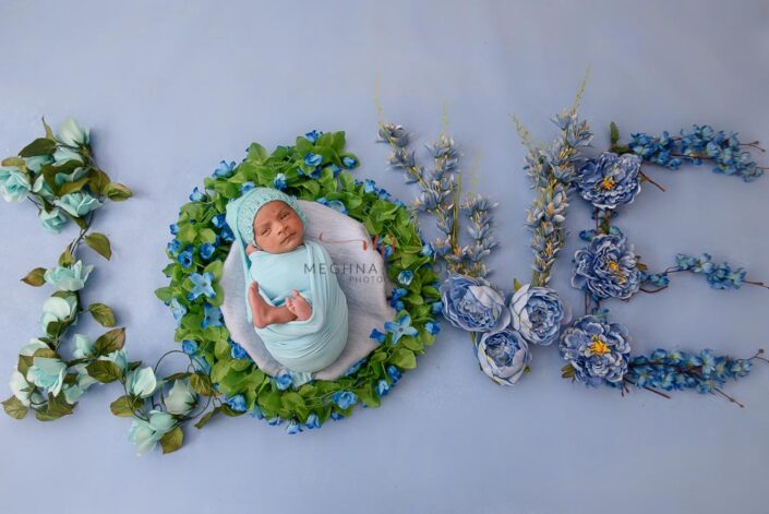 21 days old newborn baby boy photoshoot props decorated with flowers meghna rathore photography in delhi and gurgaon
