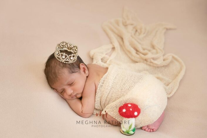 Newborn baby boy with white backdrops and props at meghna rathore photography in Delhi