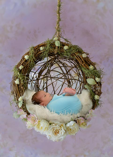 23 days old newborn baby boy posing with props and theme at meghna rathore photography in delhi
