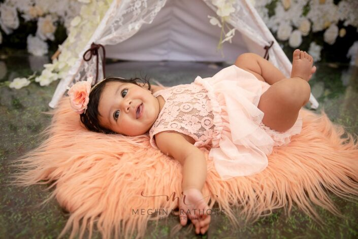 4 months old baby girl photoshoot with theme and props posing at meghna rathore photography in delhi