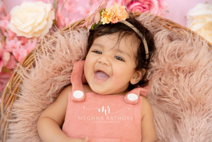 Baby girl professional photoshoot with props like flowers and tiara at meghna rathore photography in delhi and gurgaon