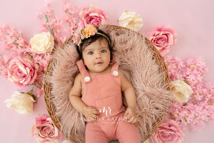 4 months old baby girl pink colored theme and props professional photoshoot at meghna rathore photography in delhi and gurgaon