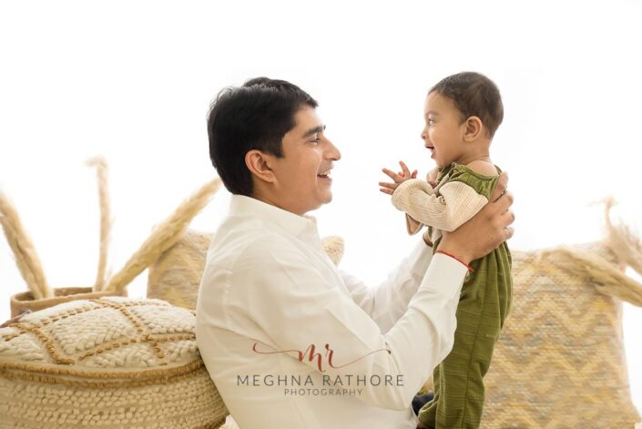 9 months old baby boy posing with his father and theme based professional photoshoot at meghna rathore photography in noida