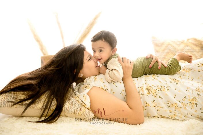 9 months old baby boy posing with his mother and theme based professional photoshoot at meghna rathore photography in noida