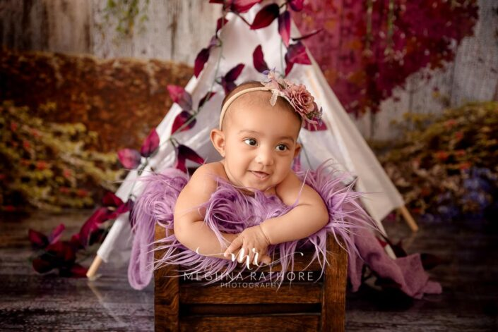 Baby girl posing - mid close up shot with a theme and props around her at meghna rathore photography in delhi and gurgaon