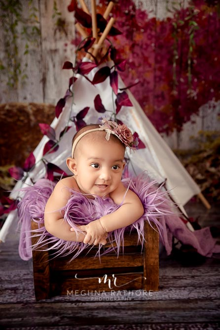 Baby girl posing with a theme and props around her at meghna rathore photography in delhi and gurgaon