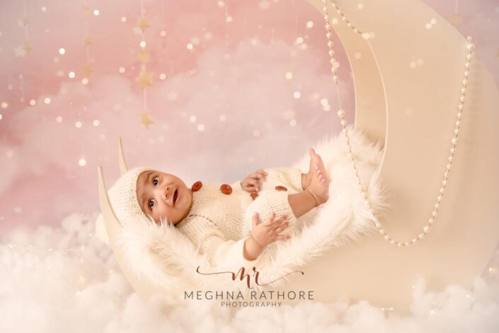 Baby girl posing with a moon based theme and props at meghna rathore photography in delhi gurgaon