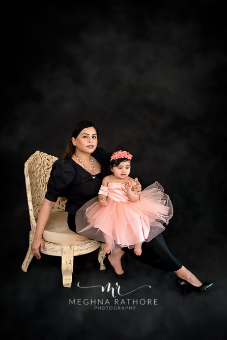 Mother and daughter duo posing together at meghna rathore photography in delhi gurgaon