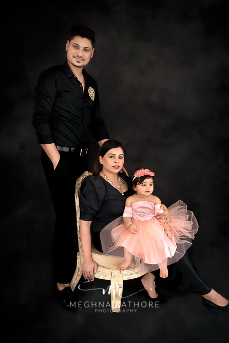 Family portrait with one year old baby girl all posing at meghna rathore photograhy in delhi gurgaon