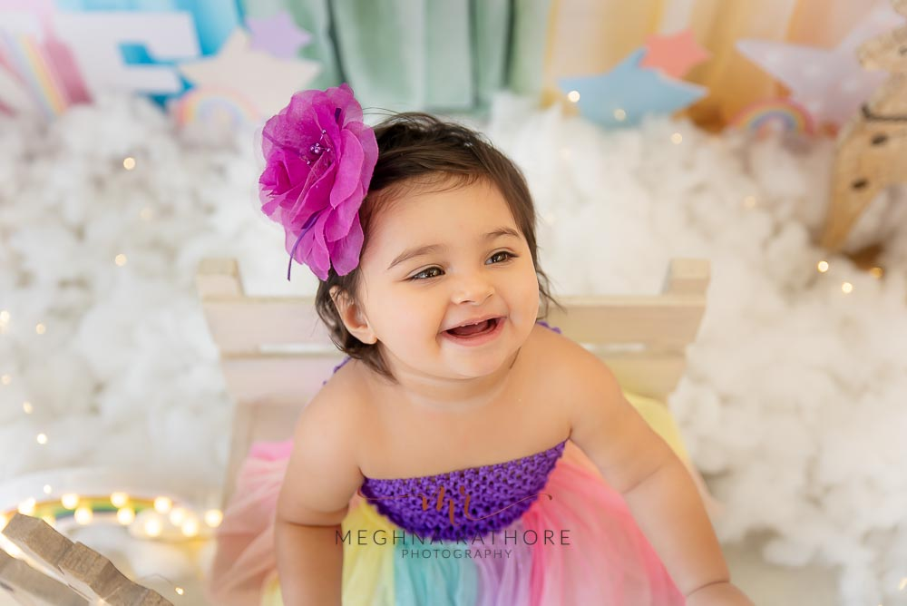 1 year old cute girl photo shoot poses for cake smash