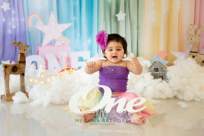 1 year old girl kid professional photoshoot laughing candid posing at meghna rathore photography in delhi gurgaon