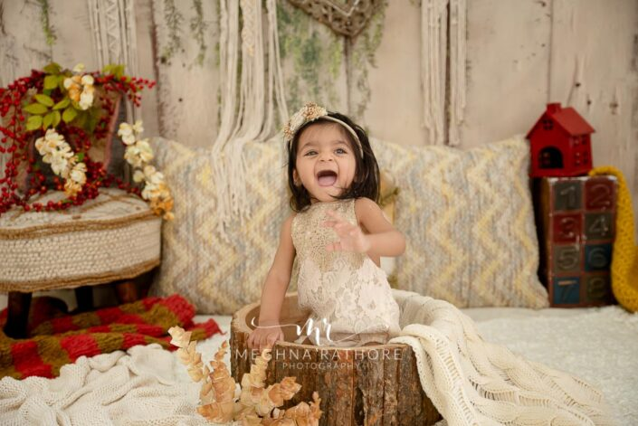 1 year old cute girl photo shoot poses smiling brightly for meghna rathore photography in delhi gurgaon