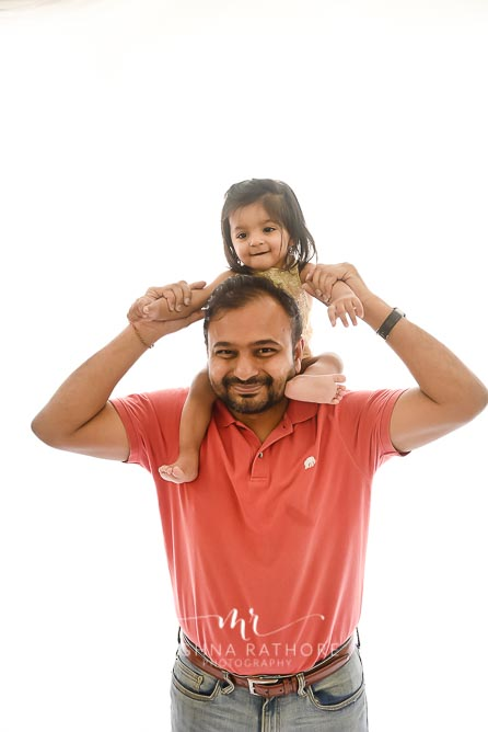 Father and daughter posing together candidly at meghna rathore photography in delhi gurgaon