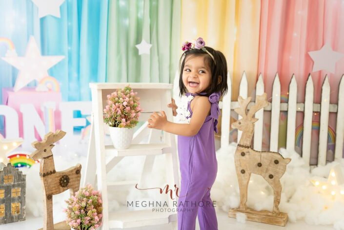 1 year old cute girl poses standing candidly for meghna rathore photography in delhi gurgaon