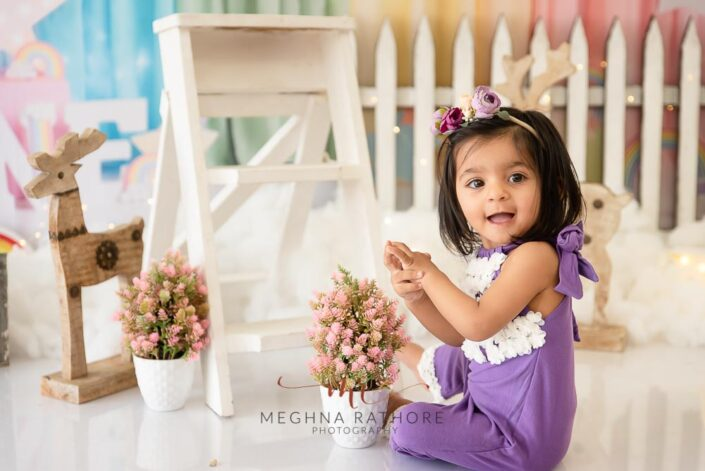 1 year old cute girl photo shoot poses candidly for meghna rathore photography in delhi gurgaon