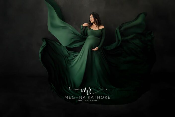 Maternity professional photoshoot elegant lady posing in green gown at meghna rathore photography in delhi gurgaon