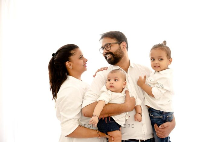 Family portrait of 6 months old boy and his family posing at meghna rathore photography in delhi gurgaon