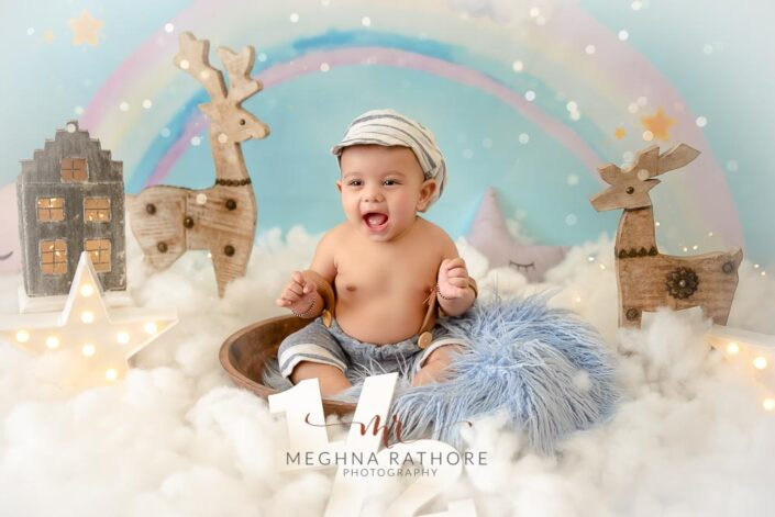 6 months old baby boy posing in theme based and props around him professional photoshoot at meghna rathore photography in noida