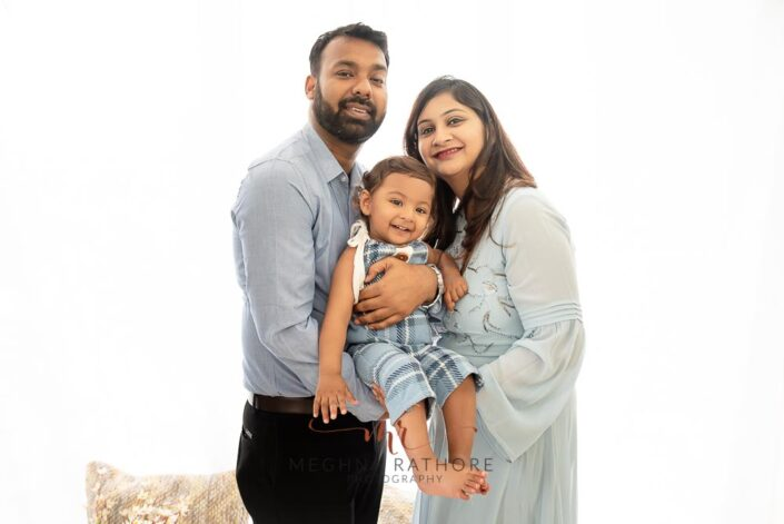Family portrait with one year old baby boy all posing at meghna rathore photograhy in delhi gurgaon