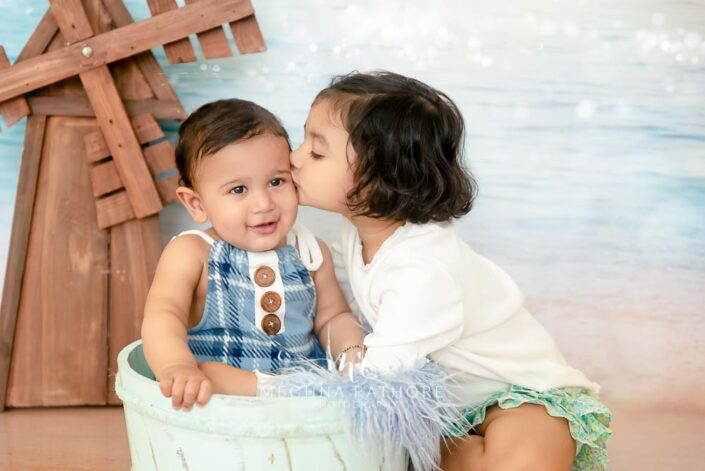 7 months old baby boy and sister posing with theme based professional photoshoot at meghna rathore photography in noida