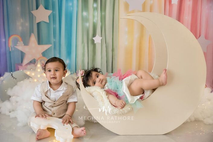 7 months old baby boy and baby girl posing with sky theme based professional photoshoot at meghna rathore photography in noida