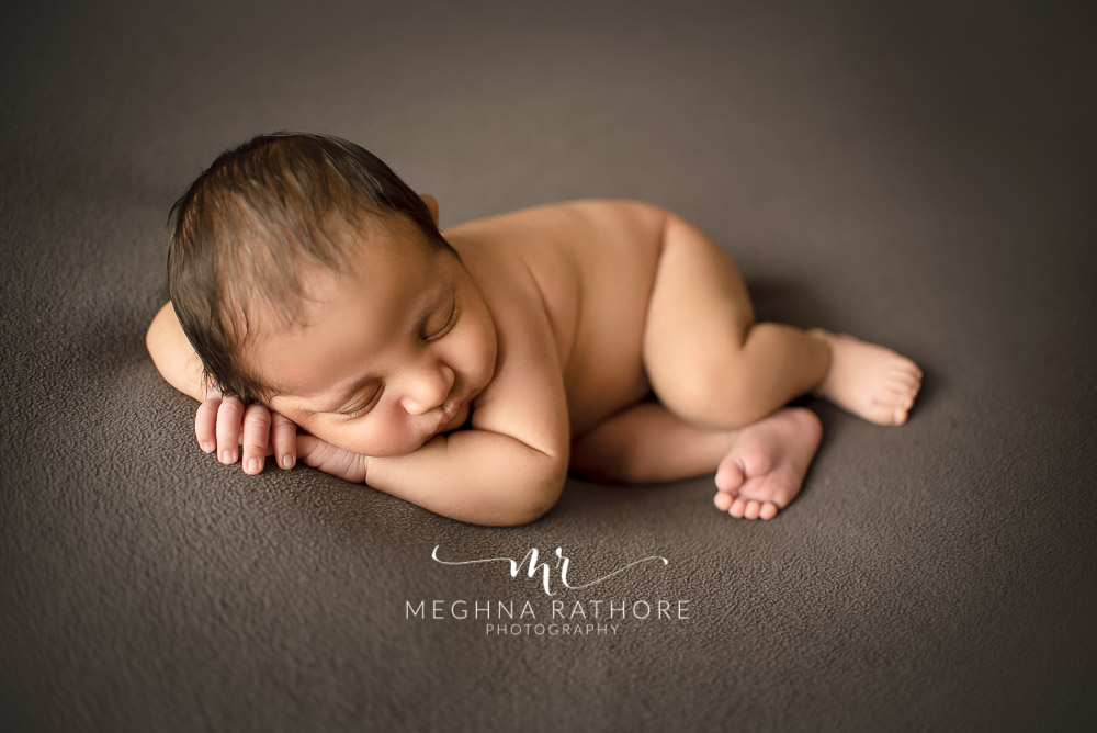 24 days old newborn baby boy posing adorably in professional photoshoot set up at Meghna Rathore photography in gurgaun, new delhi and noida