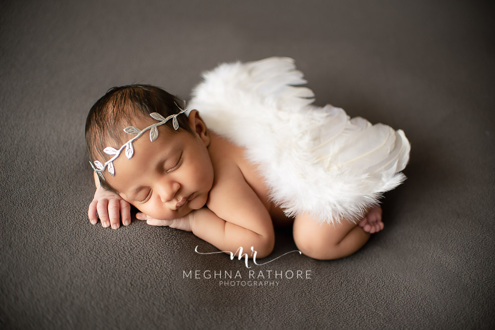 24 days old newborn baby boy posing like an angel in professional photoshoot set up at Meghna Rathore photography in gurgaun, new delhi and noida