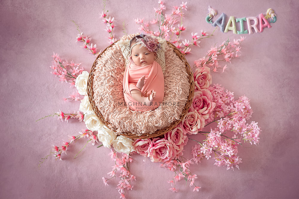 24 days old newborn girl child best indoor photo studio pink theme leaves and flowers at meghna rathore photography in gurgaoun
