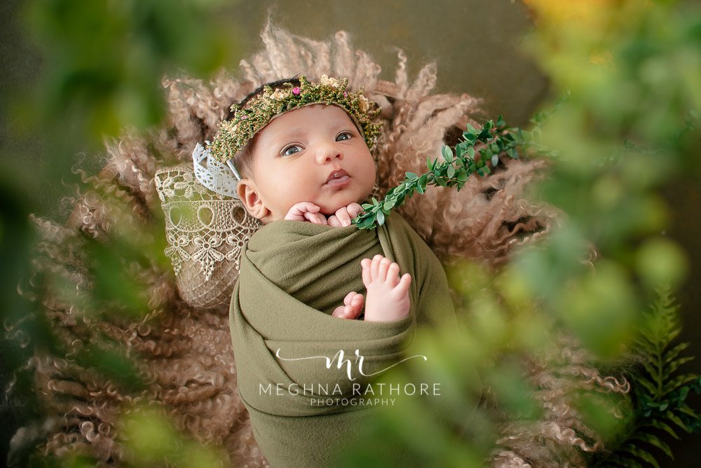 24 days old newborn girl child best indoor photo studio baby posing and smiling at meghna rathore photography in gurgaoun